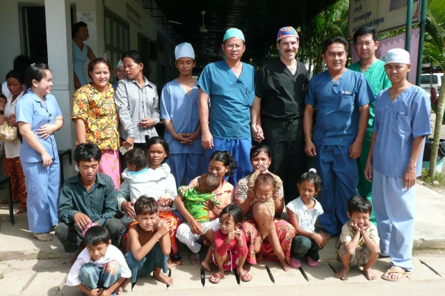 Lt. Col. Kevin Winkle, ophthalmologist (in black) with Cambodian ophthalmology colleagues and many of their patients.
