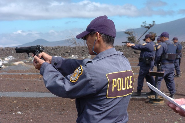 POHAKULOA TRAINING AREA, Hawaii - Efren Vicente, DA PTA police officer,  and other police officers shoot their targets.