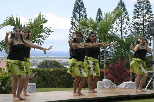 HONOLULU - Polynesian dancers entertain the crowd at the first annual Founder's Day. The event was in celebration founder Zachary Fisher's dedication to the armed forces in providing comfort homes for families of hospitalized military personnel.