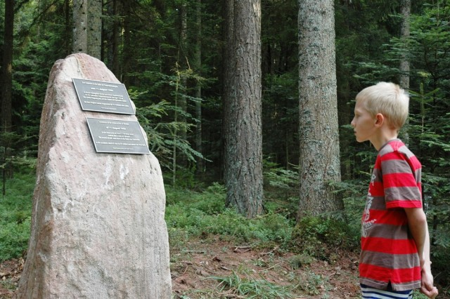 A young boy stands face to face with history. This year, the city of GrAfAPmbach unveiled a memorial stone, where a C-199 transport plane crashed in the woods some 53 years ago