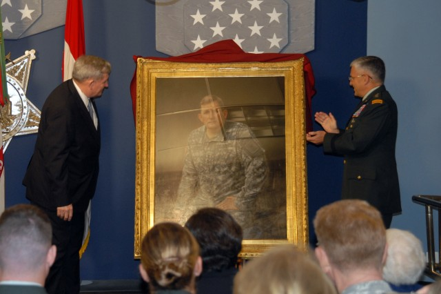 General (Retired) Peter J. Schoomaker, left, and Chief of Staff of the Army Gen. George W. Casey, Jr. reveal the portrait in the Hall of Heroes, October 10, 2008. Schoomaker chose to be depicted in his Army Combat Uniform because he felt it symbolized the Warrior Ethos and the transformation of the Army to an expeditionary force.