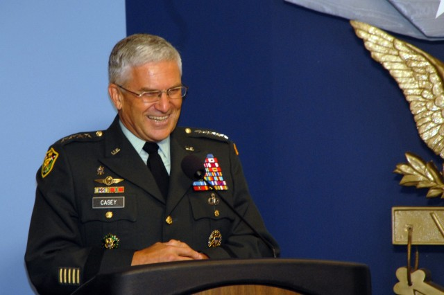 Chief of Staff of the Army, Gen. George W. Casey, Jr. jokes with the audience during opening remarks at Gen. (Retired) Peter J. Schoomaker's portrait unveiling at the Pentagon, October 10, 2008. Casey praised Schoomaker as a committed and courageous person and leader.