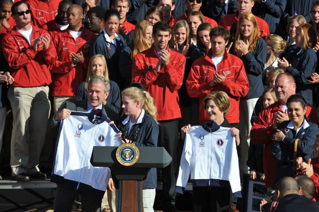 President Bush and first lady Laura display official Team USA Olympic jackets after being proclaimed honorary members of the team by 2008 U.S. Olympic and Paralympic athletes Oct. 7 on the south lawn of the White House.