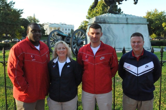 "U.S. Army World Class Athlete Program Olympians Staff Sgt. Dremiel Byers, Staff Sgt. Elizabeth ""Libby"" Callahan, Staff Sgt. Keith Sanderson and Maj. Dave Johnson pose outside the White House before a group of 2008 U.S. Olympians and Paralympians visit President Bush on Oct. 7."