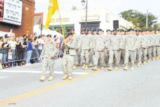 Soldiers of the 2nd Bn., 69th Armor Regt., 3rd HBCT, 3rd Inf. Div., march in a parade, Sept. 26 at the Duluth (Ga.) Fall Festival.