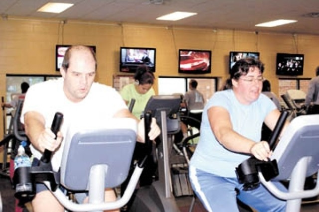 Belgium Exchange Officer Maj. Marc Bouthe and his wife Kristien take time to work out in Newman's Cardio room.