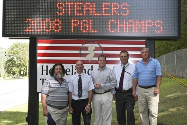 "PICATINNY ARSENAL, N.J. -- Members of Picatinny's Stealers golf team pose in front of the installation electronic sign. They are (from left) Walt Wurster, Jeff Boyle, Matt Jones, Dave Hansen and Brian Wolfinger. The Stealers won the 2008 Picatinny Golf League Championship. There were 32 teams divided into two 16-team divisions. The league started April 29 and ended Aug. 26. The Stealers won the ""A"" division and the Nitwits won the ""B"" division. Then the Stealers and the Nitwits played two matches to decide the league champions. However, at the end of these matches the teams remained tied, but the Stealers went on to win the first playoff hole to secure the PGL title."