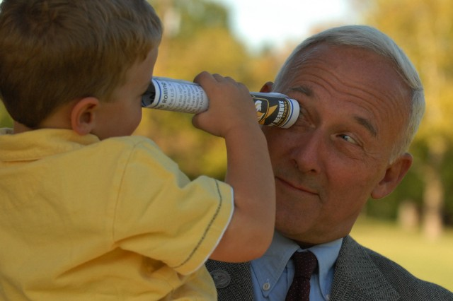 99th RSC Chief Executive Officer Bill Staub shares a spyglass moment with his grandson Jack Wilson at the reception following the ceremony.