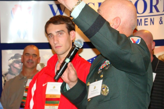 RedstoneAca,!a,,cs top finisher David Riddle (50:51) is introduced by AMCOM commander Maj. Gen. Jim Myles during a reception for the Redstone-Huntsville Chapter of the Association of the U.S. Army.