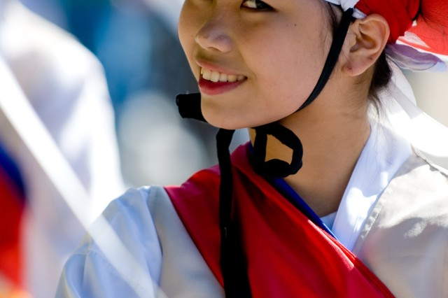 A Korean traditional dancer smiles during the 2008 Yongsan Fall Festival Parade Oct. 11 on Yongsan Garrison, Seoul, Republic of Korea. Nearly 5,000 Koreans and Americans enjoyed the day-long celebration of autumn.