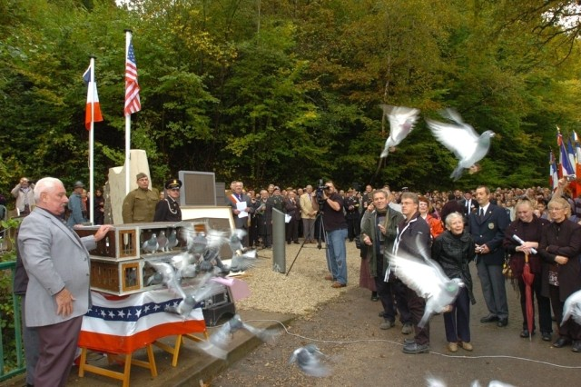 "Pigeons were released as a tribute to the fallen American Soldiers who served with the Lost Battalion. A memorial monument dedication ceremony to honor the 77th ""Liberty"" Division's Lost Battalion was held at Binarville, France, Oct. 7."