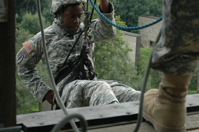 A member of the 1/10th Special Forces Group [Airborne] gets ready to step off the skid, a part of the Stuttgart, Germany, Military Rappel Tower, which replicates the descent a Soldier might take from a helicopter, such as a Blackhawk.