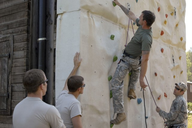 Sgt. Ken Powell, middle, instructs members of the 1/10 Special Forces Group [Airborne] on the climbing wall at Stuttgart, Germany, while Sgt. 1st Class Joshua Whitty, right, runs the belay.