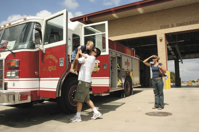 The Lewis Family checks out Fire Engine No. 1 during the Fort Sam Houston Emergency Service Fire Prevention Week Open House Oct. 11 at the fire station here. A variety of emergency vehicles were on display including an ambulance and military police car.
