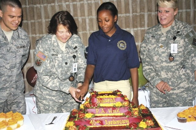 (From left) Air Force Capt. Steve Carlsen; Lt. Col. Pauline Gross, Interservice Physician Assistant Program branch chief; 2nd Lt. Diana Jones, PA student; and Maj. Pamela Roof, IPAP instructor, cut a cake in honor of National PA Week Oct. 9 at Evans Theater at Fort Sam Houston.