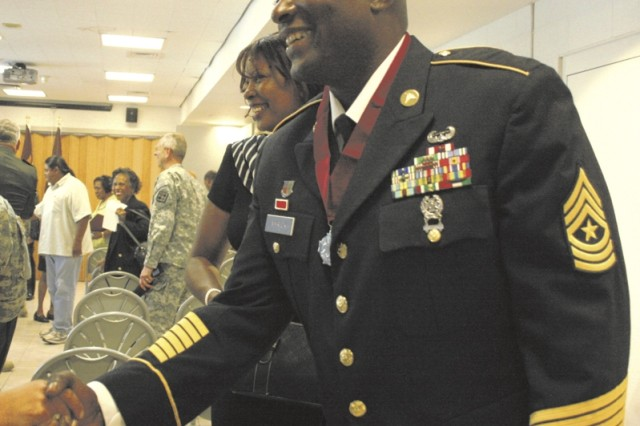 Sgt. Maj. Henry Myrick II and his wife, Kathy, receive congratulations from well-wishers after he received the Order of Military Medical Merit medallion Oct. 9 at the Army Medical Department Museum. Myrick, sergeant major of the Department of Combat Medic Training, was recognized for his teaching, coaching and mentoring of countless numbers of Soldiers during his 20 years of service.