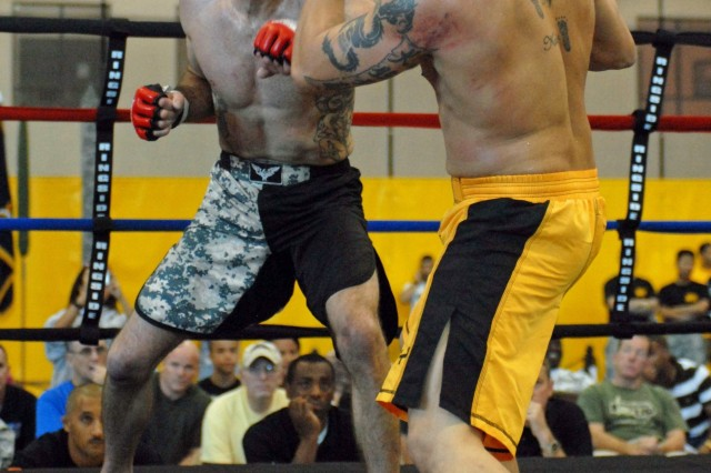 Staff Sgt. Keith Bach of the 3rd Infantry Division, Fort Stewart, Ga. (left) and Staff Sgt. William Haggerty of 95th Civil Affairs, Fort Bragg, N.C., fight in the finals of the Army Combatives Championship at Fort Benning, Ga., Oct 5. Bach earned 1st place in the lightweight category.