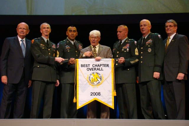 Redstone-Huntsville leaders accept the Best Overall Chapter award at the 2008 AUSA annual meeting and exposition Oct 6. From left are retired Gen. Gordon Sullivan, AUSA president; Lt. Gen. Kevin Campbell, commander of Space and Missile Defense Command; Command Sgt. Maj. Ralph Borja of SMDC; Michael Howell, Redstone-Huntsville chapter president; Command Sgt. Maj. Ricky Yates of Aviation and Missile Command; Maj. Gen. Jim Myles, commander of AMCOM; LTG (ret) Roger G. Thompson, vice president for membership and meetings for AUSA