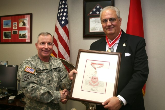 Reconstruction director receives Order de Fleury