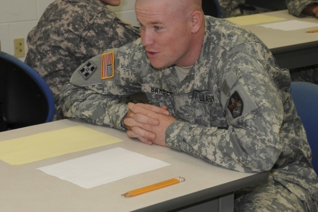 Staff Sgt. Christopher Barber, U.S. Space and Missile Defense Command/U.S. Army Forces Strategic Command, prepares to take the written exam during the 2008 Noncommissioned Officer/Soldier of the Year competition Oct. 1 at Fort Lee, Va.