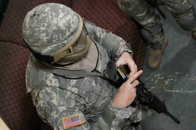 Staff Sgt. Christopher Barber, Space and Missile Defense Command/Army Forces Strategic Command, receives a full magazine of simulation rounds just before the group of warriors conduct a room-clearing and hostage rescue scenario during the 2008 Department of the Army NCO/Soldier of the Year Competition, Sept. 28 - Oct. 3, at Fort Lee, Va.
