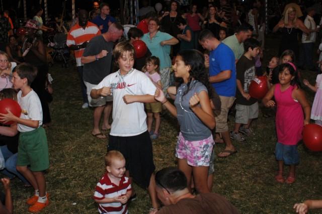 "SCHOFIELD BARRACKS, Hawaii - Chance Margotta and Nikki Stewart (center) and dozens of family members flock to the dance floor for the ""Chicken Dance"" at Oktoberfest 2008, Oct. 3."