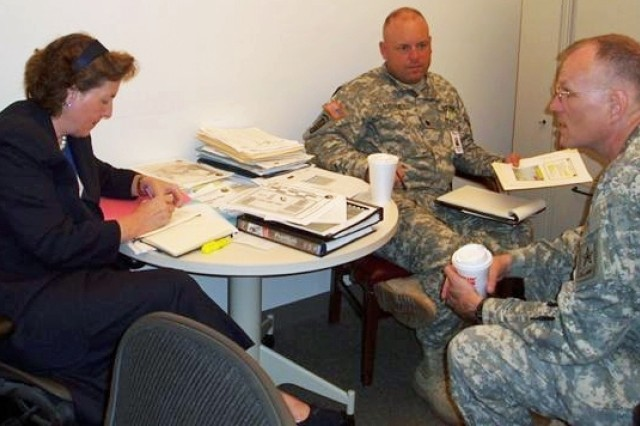 Helen Tierney plans next steps with the Army Contracting Campaign Plan Task Force while coordinating with Lt. Gen. George Harris, right, and Lt. Col. Pat Maloney.