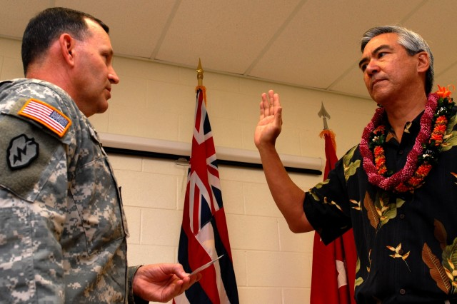 HILO, Hawaii - Lt. Gen. Benjamin Mixon, commander, U.S. Army-Pacific, swears in Hawaii island native William Moore as a Civilian Aide to the Secretary of the Army on behalf of Secretary of the Army Pete Geren.