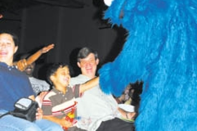 Cookie Monster leaves the stage Oct. 10 to visit children in the audience at the Sesame Street Experience on Fort Stewart.
