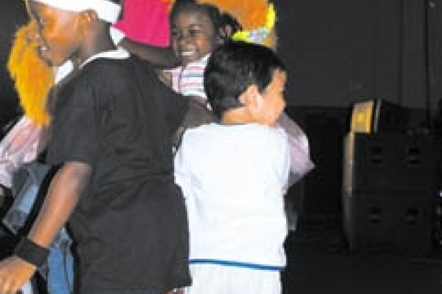 Children mob Zoe Monster at the Sesame Street Experience Oct. 10 at Newman Fitness Center.  The show was designed for military Families and addressed issues children have to face, such as multiple deployments.