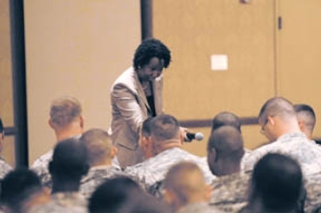 Pat Fleming, Financial Advisor, answers questions about financial concerns for Soldiers and Family members during 1/64 Armor, 2nd BCT, 3rd ID, Phase II reintegration training, held at Club Stewart, Oct. 7