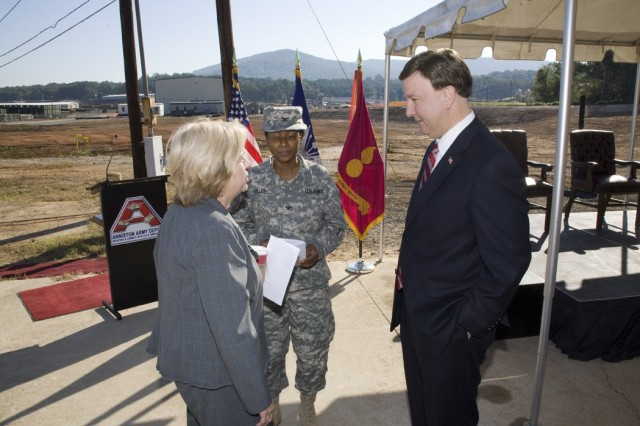 Prior to the start of the ceremony, Ann Worrell and Depot Commander Col. S. B. Keller discuss the value of the new Industrial Wastewater Treatment Plant  with Congressman Mike Rogers.