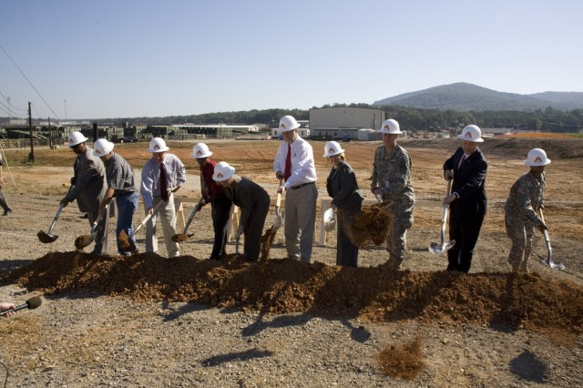 Depot and community officials turned the soil at the site of the new Industrial Wastewater Treatment Plant on Oct. 15.  Participating are:  (l to r) Col. S. B. Keller, Congressman Mike Rogers, Col. Byron Jorns, Ann Worrell, Mike Mathews, Frances Pettis, Otis Crowder, Tim Smith-Lindsey, Ray Hester and Everett Kelley.