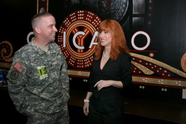 SGT Duggan Myron, U.S. Army Chicago Recruiting Battalion, talks with comedian and actress, Kathy Griffin, before her performance at the historical Chicago Theater, Thursday, October 16.  Chicagoland Soldiers were recognized by the comedian during the sold-out performance.