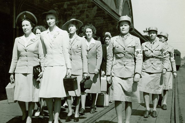 Newly arrived Women's Army Auxiliary Corps recruits, at Fort Des Moines, Iowa, 1942. (U.S. Army Signal Corps Collection). <br/><a href=http://www.army.mil/women/ target=_blank>Women in the U.S. Army</a> <br/><a href=http://www.army.mil/-news/2008/10/19/13127-my-best-soldiers-thirty-six-years-of-the-womens-army-corps/index.html target=_blank>Related Article</a>