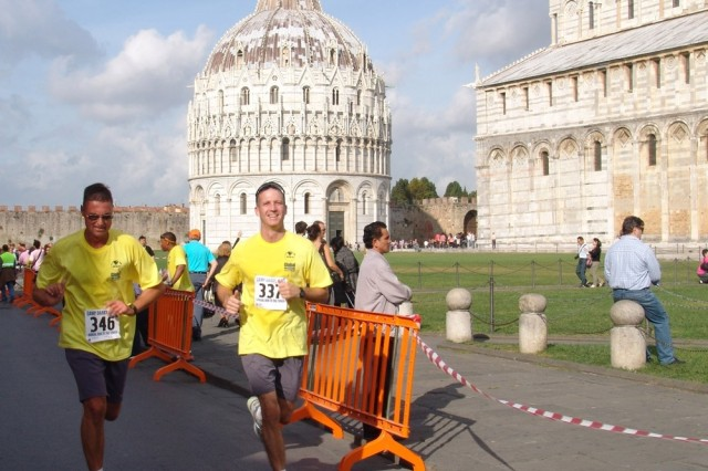 Col. Erik Daiga, left, commander of U.S. Army Garrison Vicenza, Italy, and Lt. Col. Steven Cade, commander of U.S. Army Garrison Livorno, Italy, finish the 12-kilometer run from Camp Darby to the Leaning Tower of Pisa.
