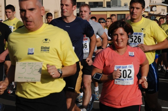 Vicki Long, number 602 in the orange shirt, initially trained for the Campy Darby Run to the Tower in 2006, but this is the first year that she has actually competed in the annual 12-kilometer race that starts at U.S. Army Garrison Vicenza, Italy, and ends at Pisa's famous Leaning Tower.