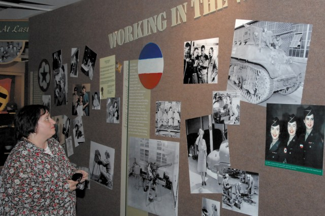 Debbie Kilpatrick, a former member of the Women's Arrmy Corps an now an environmental protection specialist at Fort Lee, Va., looks through the history of the WAC at the U.S. Army Women's Museum at Fort Lee.