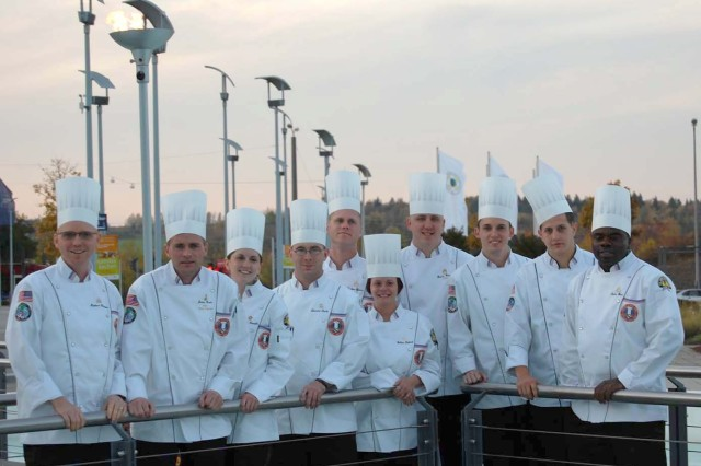 The U.S. Army Culinary Arts Team poses in front of the Olympic Torch, as they prepare to compete against 13 foreign military teams during the World Culinary Olympics, Oct. 19 - 22, in Erfurt, Germany.