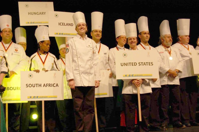 The U.S. Army Culinary Arts Team takes to the stage with 13 foreign military teams at the opening ceremony of the World Culinary Olympics, Oct. 19 - 22, in Erfurt, Germany.