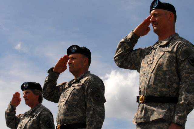 FORT SHAFTER, Hawaii - (from left) Maj. Gen. Donna Dacier, outgoing commander of the 311th Signal Command (Theater), Lt. Gen. Benjamin R. Mixon, commander, U.S. Army, Pacific, and Brig. Gen. Alan Flynn, incoming commander for the 311th, salute the U.S. flag during the playing of the national anthem for a change of command ceremony at Fort Shafter's historic Palm Circle.