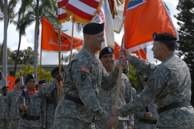 FORT SHAFTER, Hawaii -- Commander, U.S. Army, Pacific, Lt. Gen. Benjamin R. Mixon,  passes the 311th Signal Command (Theater) colors to 311th Incoming Commander Brig. Gen. Alan Lynn signifying the official change of command from Outgoing Commander Maj. Gen. Donna Dacier during an Oct. 17 ceremony at Fort Shafter's historic Palm Circle.