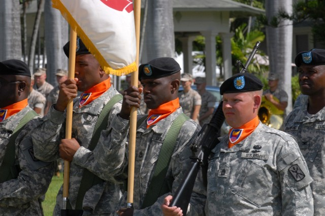 FORT SHAFTER - A color guard consisting of Soldiers from the 311th Signal Command (Theater) march towards the center of the parade field during an official ceremony welcoming Incoming 311th Commander Brig. Gen. Alan Lynn and honoring outgoing commander Maj. Gen. Donna Dacier.""