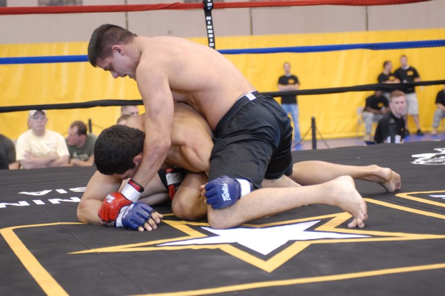 Capt. Brandon Bear (top), of Fort Riley's Warrior Transition Battalion, fights for control over one of 11 opponents he faced Oct. 3-5 during the 2008 U.S. Army Combatives Tournament at Fort Benning, Ga. The 1st Inf. Div. team took first place in the tournament.