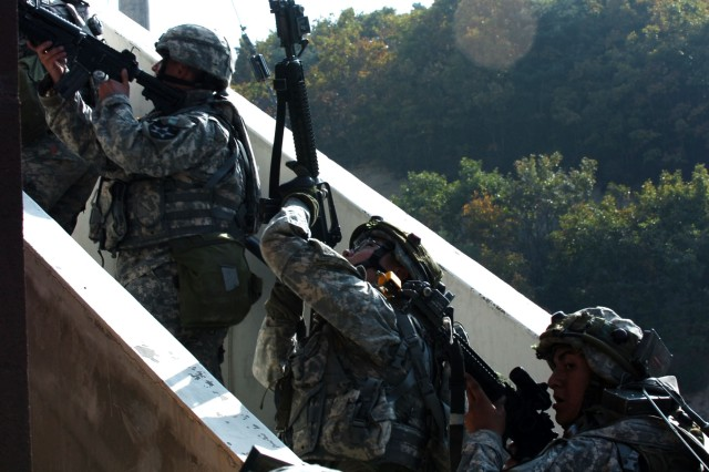 Soldiers from Co. E clear a stairwell during urban operations training.