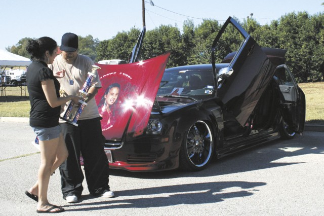 Ryan Bottorf was awarded the first place trophy at the 2008 Fall Fest car show. The car show was one of numerous Fall Fest activities Oct. 18 at MacArthur Parade Field.