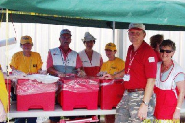 Local Red Cross volunteer Joe Sims, in front second from right, enjoys meeting other Red Cross volunteers from across the nation through his work in providing hot meals and supplies to victims of hurricanes. This picture was taken at the kitchen/feeding site at the First Baptist Church in Liberty, Texas, following Hurricane Ike where about 10,000 meals were prepared and served each day.