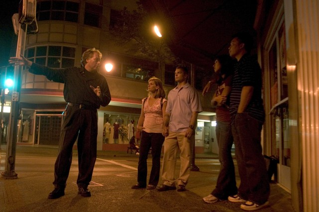 HONOLULU - (From left to right) Tour guide Steve Fredrick tells tales of ghosts and gore on streets of downtown Honolulu. Participants Angie Johnson, family member; Chief Warrant Officer 2 Eric Johnson, 3rd Battalion, 25th Aviation Regiment; Amber Vuong and Hong Vuong, listen attentively to the tales of haunted building and strange occurrences in the historic district.
