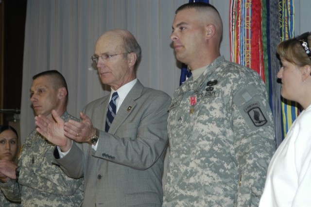 "Secretary of the Army Pete Geren (second from left) leads the applause for Cpl. Jonathan James after awarding him the Bronze Star Medal with ""V"" device for his action during Operation Enduring Freedom  in Afghanistan, where he helped defeat an enemy ambush."