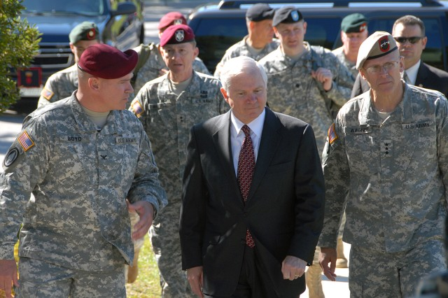 Defense Secretary Robert M. Gates, center, speaks with Lt. Gen. Robert W. Wagner, right, commanding general of the U.S. Army Special Operations Command, and Col. Curtis Boyd, commander of the 4th Psychological Operations Group, Airborne, during a visit to Fort Bragg, N.C., Oct. 23. During the vist, Gates toured several facilities used to train Army Special Operations Forces.